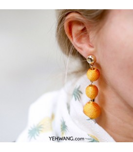 Mooie gele oorbellen met 3 bollen