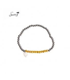 elastische armband met zilverkleurige en gele kralen